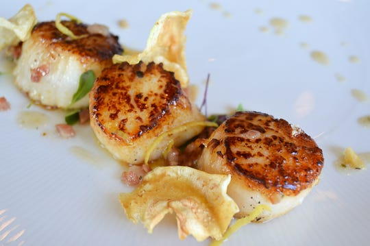 Seared diver scallops spiked with preserved lemon from Rattlesnake Club restaurant in Arlington Gardens Mall on West Plumb Lane in Reno.