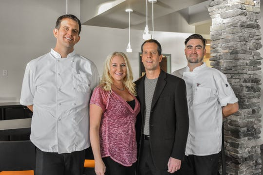 The team at Rattlesnake Club restaurant, from left: pastry chef Ethan Phelps, general manager Heidi Rockburn, owner Dr. Jeff Bacon and executive chef Drew Gruber.