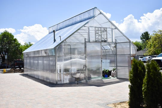 The 600-square-foot greenhouse at Rattlesnake Club restaurant in Arlington Gardens Mall on West Plumb Lane in Reno supplies herbs and produce for the kitchen. The restaurant is the only one in the city with a large on-premise greenhouse.