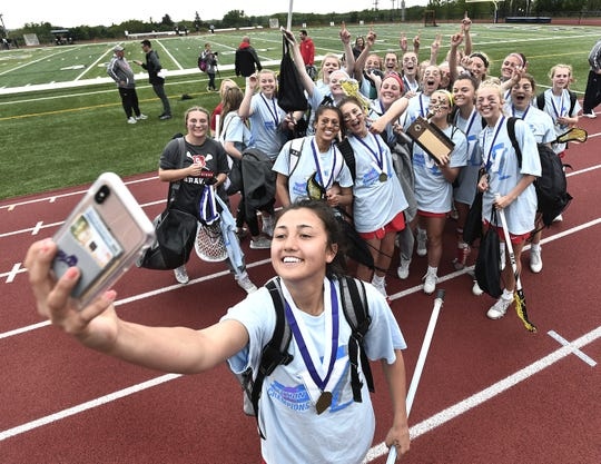 Canandaigua's Clancy Rheude takes a selfie with her teammates after their win over Spencerport in the Section V Class B Championship played at Pittsford Sutherland High School, Wednesday, May 29, 2019. No. 2 seed Canandaigua claimed the Class B title with a 9-8 overtime win over No. 1 seed Spencerport.