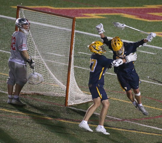 Victor's Shea Newell, right, leaps into the arms of teammate TJ Brei after scoring the winning goal with 32 seconds remaining giving Victor a 7-6 win over Canandaigua in the Section V Class B Championship game at St. John Fisher College.
