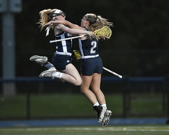 Pittsford's McKenna Davis, left, and Taylor Sampone celebrate the Panthers' sixth goal during the Section V Class A Championship played at Brighton High School, Wednesday, May 29, 2019. No. 2 seed Pittsford claimed the Class A title with a 7-6 win in four overtimes over No. 1 seed Rush-Henrietta.