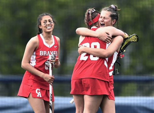Canandaigua's Lexi Braniecki, right, celebrates her game-winning goal with Meghan Ellis during the Section V Class B Championship played at Pittsford Sutherland High School, Wednesday, May 29, 2019. No. 2 seed Canandaigua claimed the Class B title with a 9-8 overtime win over No. 1 seed Spencerport.