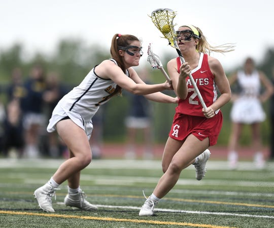 Canandaigua's LaRen Blakesley, right, is defended by Spencerport's Erin Coykendall during the Section V Class B Championship played at Pittsford Sutherland High School, Wednesday, May 29, 2019. No. 2 seed Canandaigua claimed the Class B title with a 9-8 overtime win over No. 1 seed Spencerport.