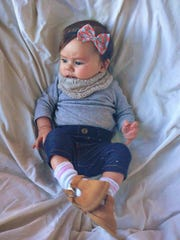 This is a picture of Audrey Zint at 4 months old wearing a headband made by her mother, Jenna, who started Turbans for Tots in 2014. Jenna Zint posted this picture of Audrey on Pinterest  and it's been re-pinned more than 800,000 times. Audrey is 5 today.