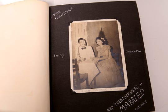 A family photo album belonging to Donald Breakey and his wife includes a photo of them together at a formal dance. He was a science professor at Willamette University for nearly 40 years. The Friends of the Salem Public Library have asked for help finding descendants of the family. Photographed at the Statesman Journal in Salem on May 29, 2019.