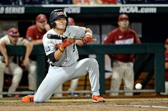 Oregon State infielder Andy Armstrong (9) bunts during the ninth against Arkansas in game two of the championship series of the College World Series at TD Ameritrade Park last season.