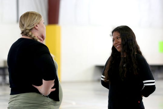 Alison Tinoco, a Gervais eighth grader, and Fenya Aman, a behavior assistant, talk in the gym at Gervais Middle School on May 30, 2019. Aman performed CPR on Tinoco when she collapsed after PE class.