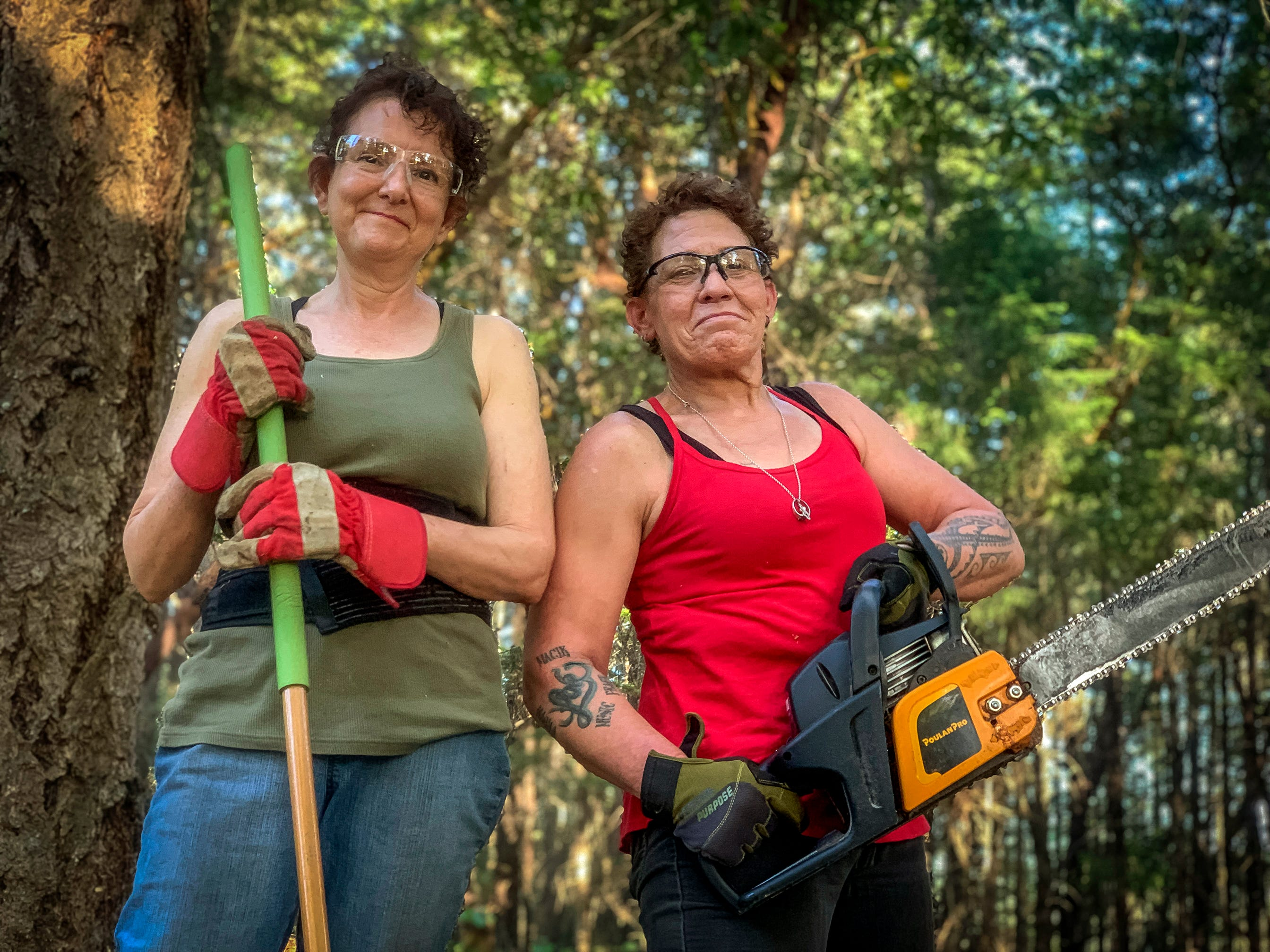 Homeowner Dawn Feldman, left with help from friend and neighbor Victoria Wertheimer is working through her wildfire fears by clearing underbrush and debris to create defensible space around her home near Merlin, Oregon. Feldman is new to the area and to wildfire threat and admits she became scared when she learned that Merlin tops a list of areas most at risk of a devastating wildlife like those in Redding and Paradise California in 2018.