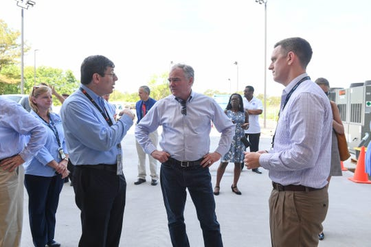 Chris Scolese, Director of Goddard Space Flight Center, speaks to Senator Tim Kaine and Sean Mulligan, Chief Operating Officer and Director of the Mid-Atlantic Regional Spaceport at the new payload processing facility on Thursday, May 29, 2019 in Wallops Island, Va.