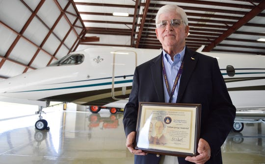 Pilot Bill Underhill poses for a photo with his award on Thursday, May 30, at a hangar at the Shreveport Regional Airport. The award is The Wright Brothers Master Pilot Award.