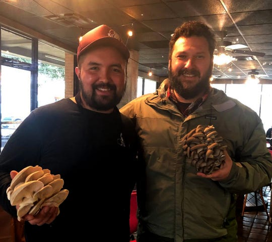 Chris Richmond of Artemis Gourmet Mushrooms delivers mushrooms to Ki Mexico's Eleazar Mondragon. Both will participate in this year's FEAST!