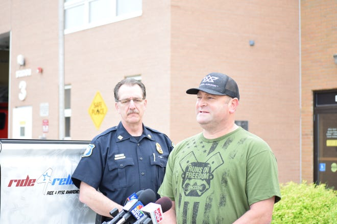 Sioux Falls Police Capt. Loren McManus (left) looks on as former police officer and firefighter Jeff Shepard shares his struggles with post-traumatic stress disorder after being involved in an ambush shooting and an IED explosion.