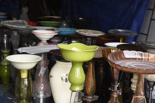 Sue Nipe's collection of bird baths.