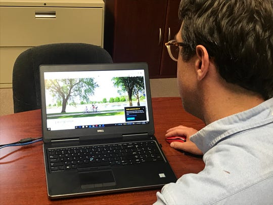 City Administrator Justin Weiland looks at the new Dell Rapids website.
