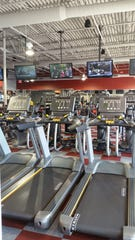 Treadmills at a Workout Anytime fitness location.