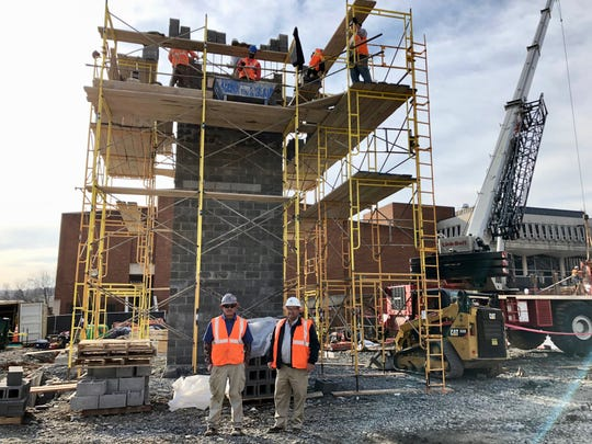 Daryl Shifflett and Antonio Perez of MH Masonry pose at a James Madison University job site in spring 2019.