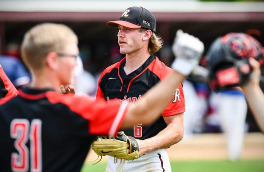 ROCORI pitcher Jack Steil heads to the dugout between innings during a Section 5-3A playoff game against Apollo Thursday, May 30, in Cold Spring.