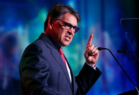 U.S. Energy Secretary Rick Perry speaks at an energy summit hosted by Utah Gov. Gary Herbert and attended by Wyoming Gov. Mark Gordon Thursday, May 30, 2019, in Salt Lake City. (AP Photo/Rick Bowmer)