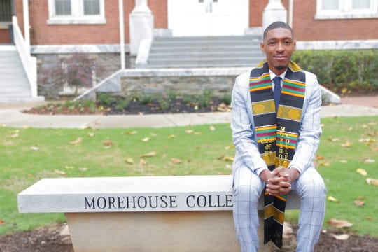 Johnnie Morris III, sitting on a bench in front of Graves Hall at Morehouse College in Atlanta. This is the residence hall of his freshman year at the college.