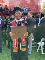 Johnnie Morris III, following his May 19 graduation from Morehouse College in Atlanta. Commencement speaker Robert Smith announced his family was committed to paying off each graduates student loan debt.