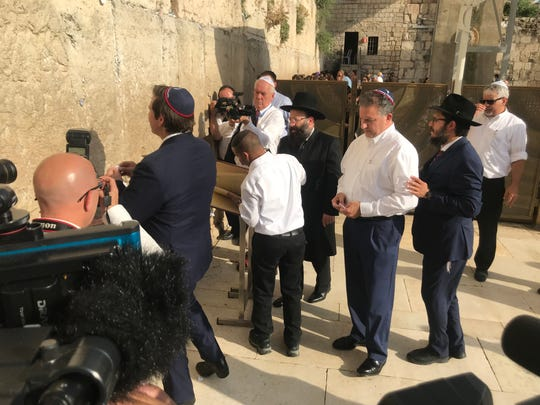 Gov. Ron DeSantis inserts a prayer for a safe Florida hurricane season in the Wailing Wall.