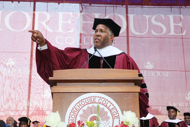 Robert F. Smith, founder, chairman and CEO of Vista Equity Partners, a tech investor firm, speaking at Morehouse College's graduation in May. Smith pledged to pay for each member of the spring Class of 2019's student debt.