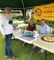 Stuart Sunrise Rotary President Mike Costopoulus, left, Silent Auction Chair Sue Zachman and Rotarian Michael Donnelly at the Dollars for Scholars Tennis Tournament.