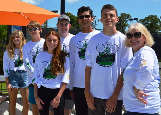 Clark Advanced Learning Center students Bailey Moselle, left, Brandon Thayer, Kaiya McCann, Nick Lynch, Prashant Jha and Daniel Patterson with Debbie Kohuth at the Dollars for Scholars Tennis Tournament.