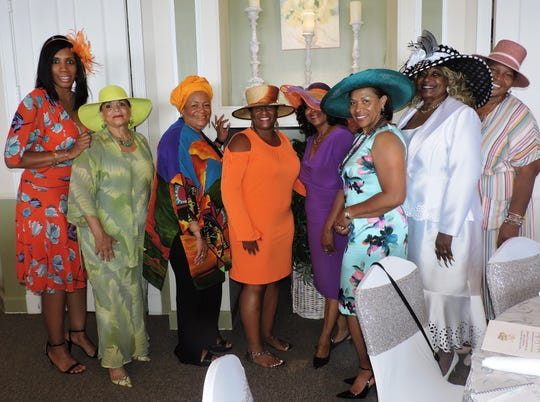Tamara Celeste, left, Mami Kisner, Gloria Shuttlesworth, Angela Shuttlesworth, Sandra Turnquest, Phyllis Gillespie, Rose Anne Brown and Patricia Copeland-Johnson at the Hats, Ties & Tea party for the PACE Center for Girls Treasure Coast.