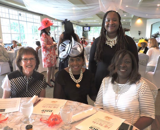 Roxann Broker, left, Dr. Elizabeth Johnson, Porche Dea and Alissa Cypress at the Hats, Ties & Tea party for the PACE Center for Girls Treasure Coast.
