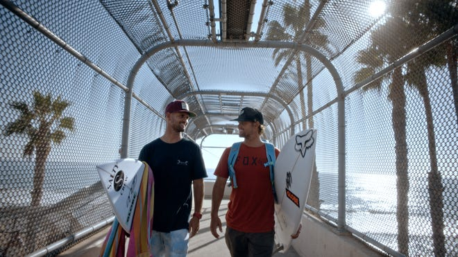 """Surfers C.J. and Damien Hobgood in a scene from """"And Two if By Sea."""""""
