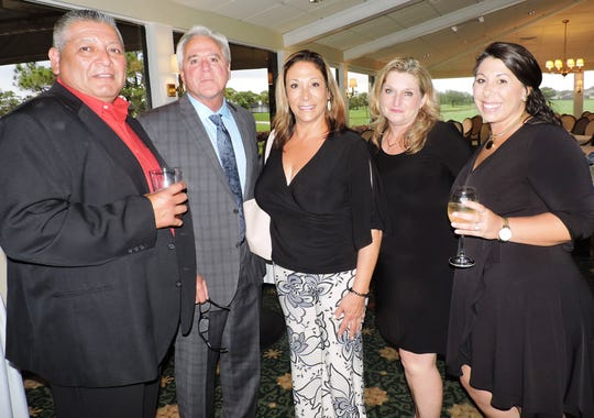 Pedro Vazquez, left, Ray Paulding, president of U.S. Paverscape, Cathy Paulding, Lisa Vasquez and Emily Paulding at the Stuart Rotary Charitable Foundation Mayors' Gala at Mariner Sands Country Club in Stuart.