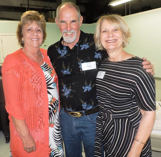 Carol Hodnett, left, Chris Perry and Vicki Davis at the Helping People Succeed Volunteer Appreciation Luncheon.