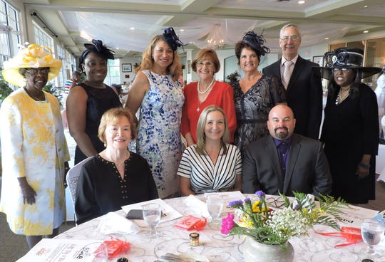 Arlena B. Lee, standing, from left, Sherrita Johnson, Vickie Colter, State Sen. Gayle Harrell, Dr. Kimberlie Massnick, Glen Massnick, and Arlena D. Lee, with Fort Pierce Mayor Linda Hudson, seated, Rochelle Popp-Finch and Claude Finch at the Hats, Ties & Tea party for the PACE Center for Girls Treasure Coast.