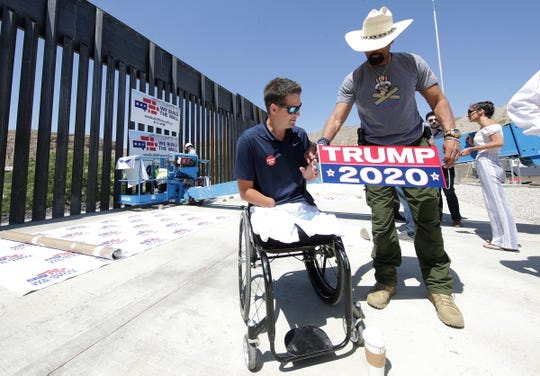 """In a photo from earlier this year, nonprofit We Build the Wall Inc. founder Brian Kolfage, left, and """"Sheriff"""" David Clarke Jr., a board member, prepare for a news conference in Sunland Park, New Mexico where the group completed its first section of privately funded U.S.-Mexico border wall."""