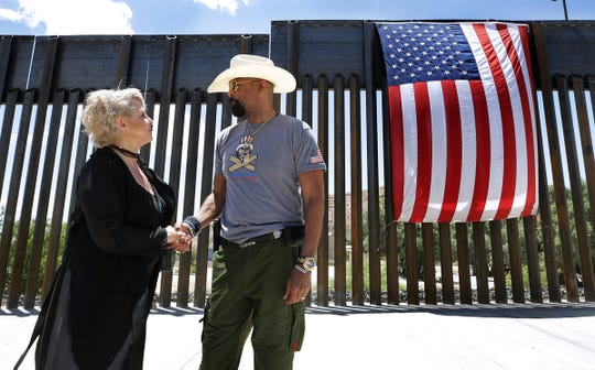 Shauna Abney, a member of the New Mexico Patriots, thanks David Clarke Jr., a board member with WeBuildTheWall, after a recent news conference at the American Eagle Brick Co., where a privately-funded wall was being constructed on the border.