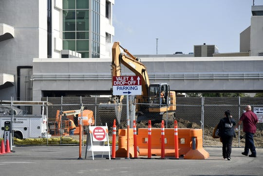 Construction crews work at the site of the new Kaweah Delta Medical Center Emergency Department last spring.