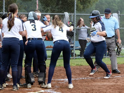 Walter Panas players welcome Rae Valt after a two-run homer in the second inning in the Section 1 softball semifinal against Pearl River May 30, 2019 in Pearl River. Walter Panas won, 3-1.