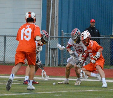 Mamaroneck long stick midfielder Declan Harrigan (right) battles for a ground ball in the fourth quarter of an 11-5 win over Niskayuna on Wednesday, May 29, 2019 at Columbia High School.