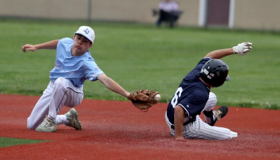 Kyle Caccimise of John Jay East Fishkill can't make the tag as Kolby Brenner of Suffern steals second base in the first inning of the Section 1 Class A semifinal baseball game at Arlington High School Wednesday, May 29, 2019. The game was suspended in the third inning due to rain.