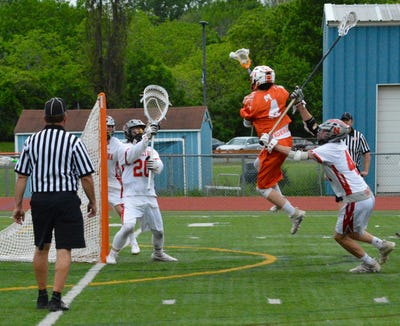Mamaroneck attackman Tom Conley rises up for the first goal of the second half. He gave the Tigers a 6-1 lead and helped them defeat Niskayuna 11-5 in a Class A regional semifinal on Wednesday, My 29, 2019 at Columbia High School.