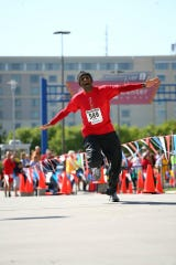 Ricky Singh finishing the Omaha Marathon.