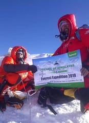 Ricky Singh poses with his crew mate at the peak of Mount Everest in Nepal on May 21.