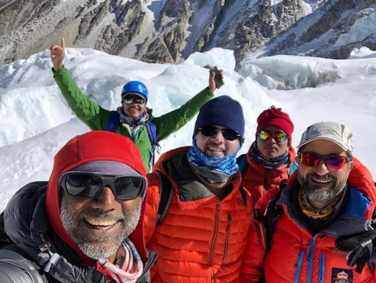 Ricky Singh poses with fellow climbers at the base of Mount Everest.