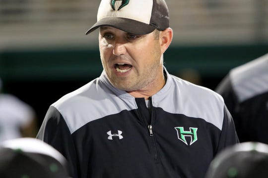 Iowa Park head coach Michael Swenson talks with his team after their 2-0 loss to Argyle Wednesday, May 29, 2019, in the Region I-4A final at Abilene Christian University.
