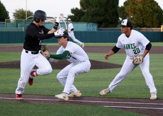 Iowa Park's Trent Green gets the tag on Argyle's Bo Hageboom Wednesday, May 29, 2019, in the Region I-4A final at Abilene Christian University.