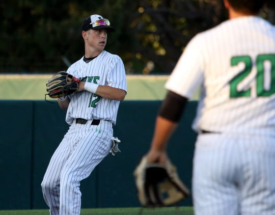Iowa Park's Kaleb Gafford gets the force out at third against Argyle Wednesday, May 29, 2019, in the Region I-4A final at Abilene Christian University.