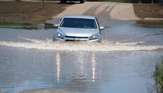 A car drives through standing floodwaters near Tulsa, Oklahoma.