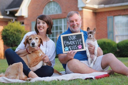 """Amy and Randy English pose with their """"favorite kids,"""" ... their two dogs."""